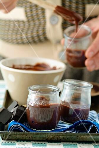 Small pots of chocolate cream dessert