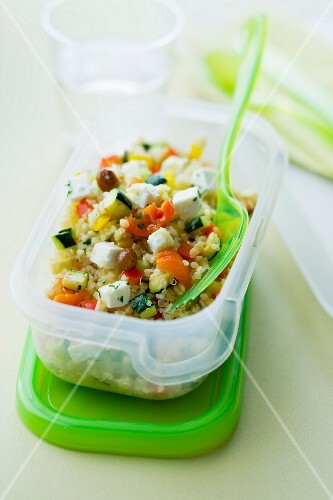 Quinoa and feta salad in a take-away plastic container