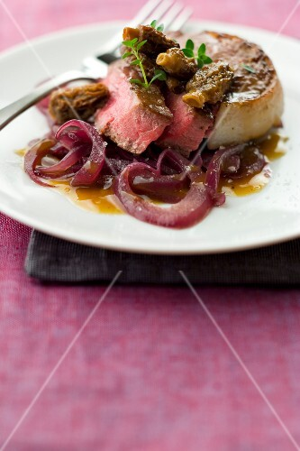 Steak with morels and onions