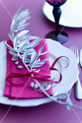 Table decoration with a silver olive branch
