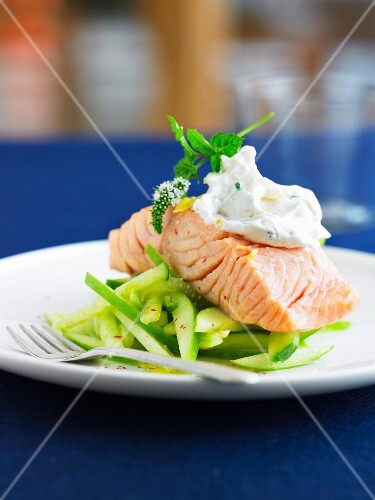 Piece of salmon with thinly sliced green apples