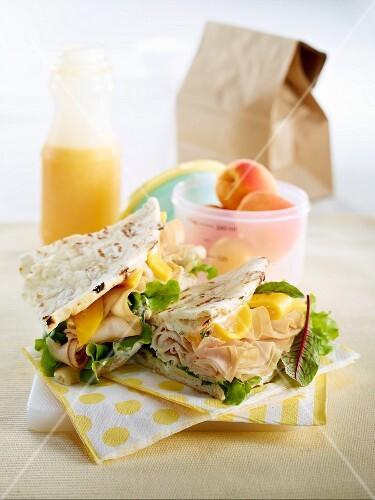 Turkey ham,mango,and beetroot leaf swedish bread sandwich
