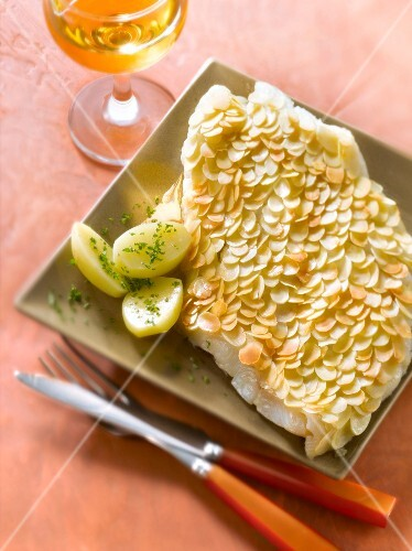 Halibut fillet with almond scales,steamed potatoes with herbs
