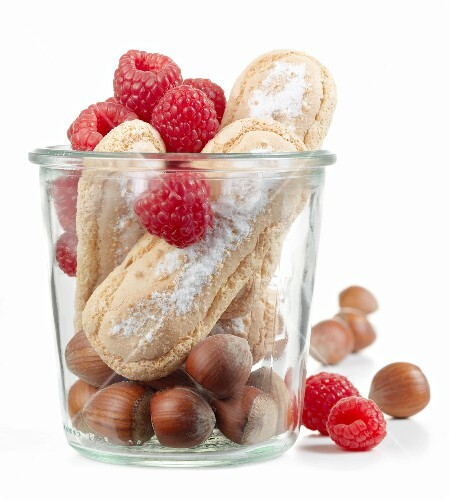 Raspberries,hazelnuts and finger biscuits in a jar