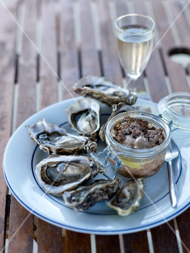 Plate of oysters and a pot of country paté