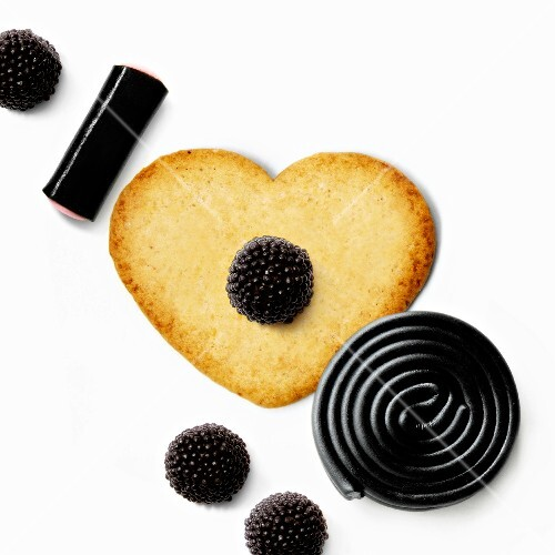 Heart-shaped biscuit with licorice candies