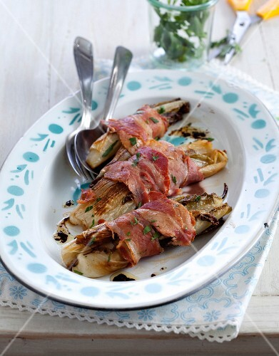 Roasted chicory wrapped in bacon