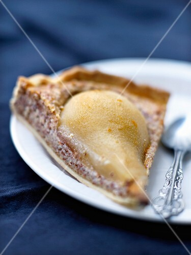 A slice of pear tart with lemon balm