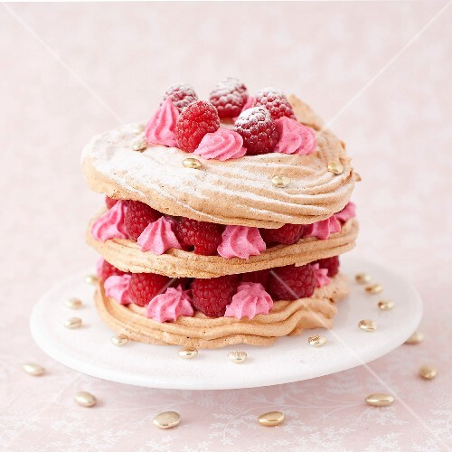 Meringue,pink whipped cream and raspberry Mille-feuille