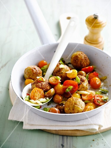 Small breaded chicken balls with cherry tomatoes