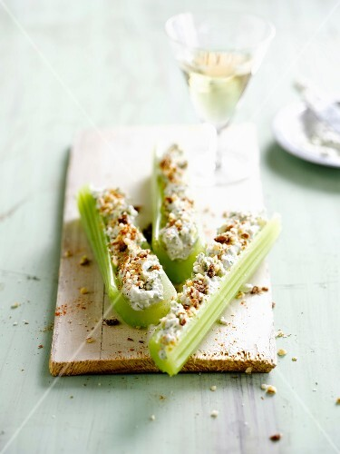 Celery stalks stuffed with cheese and walnuts
