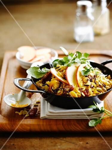 Sauteed rice with Chorizo, apple and celery stalks