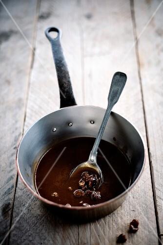 Saucepan of Port and grape sauce