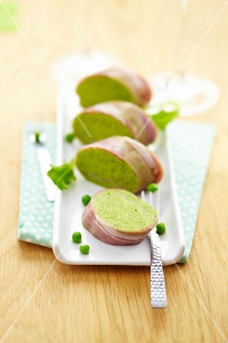 Pea mousse and raw ham sliced roll
