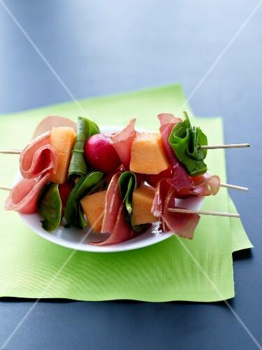 Aoste ham,melon,radish and spinach brochettes