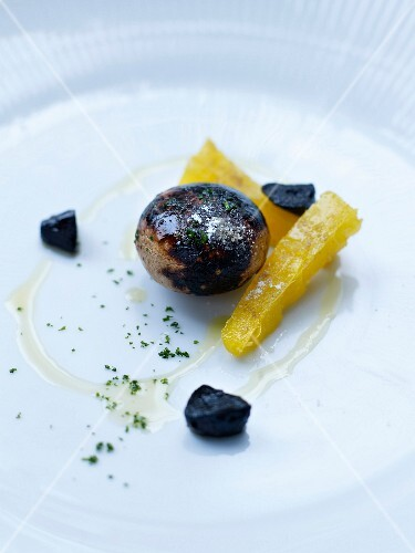 Button mushroom and black garlic with smoked Arracacha