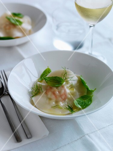 Shrimp raviolis with herb butter