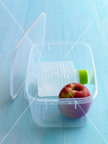 Apple and bottle of water in a lunch box