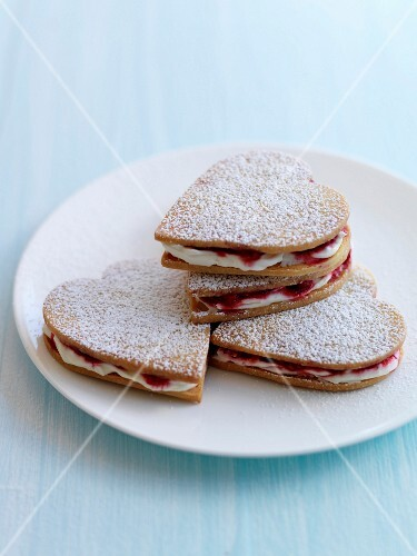 Raspberry and whipped cream crisp heart-shaped biscuits