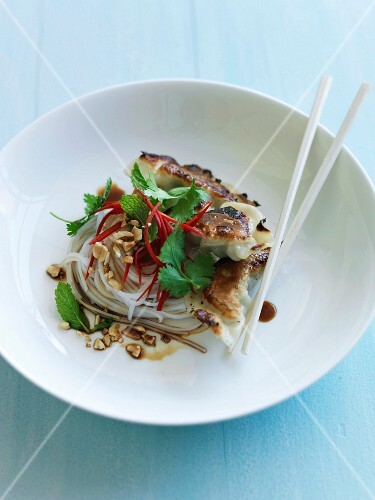 Grilled Korean dumplings with noodles and crushed peanuts