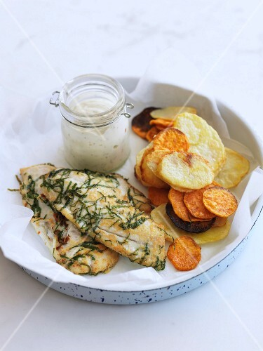 Fried cod fillets with herbs and sauteed potatoes