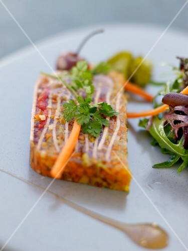 Slice of ham,herb and caper aspic terrine