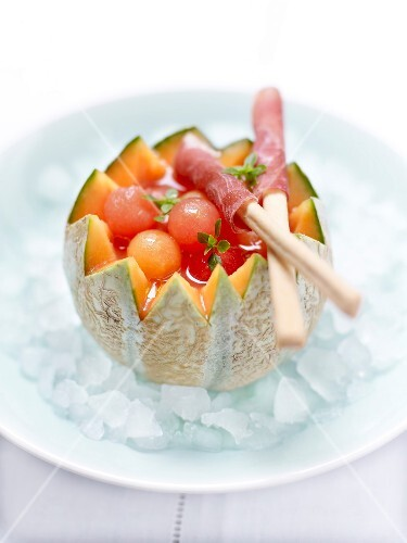 Melon and watermelon fruit salad in white Port,breadsticks with raw ham