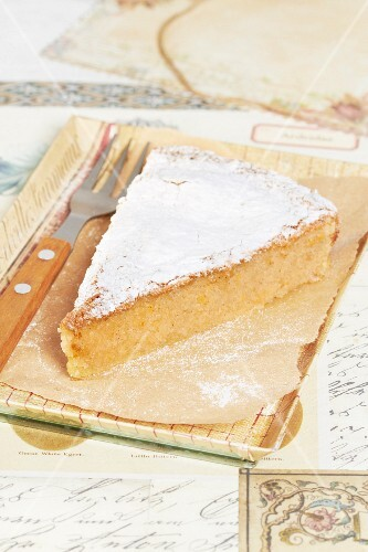 Slice of almond,cinnamon and lemon Santiago cake