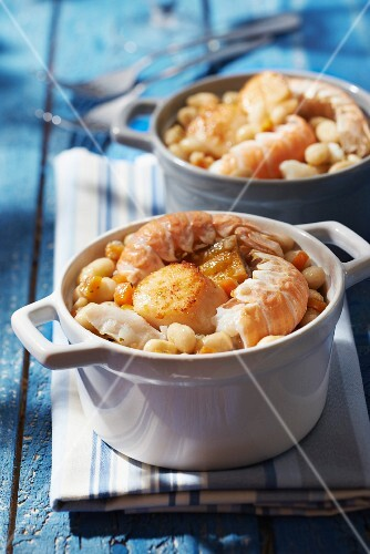 Individual seafood and white haricot bean casseroles