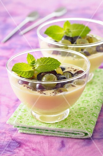 Almond cream dessert with black and white grapes
