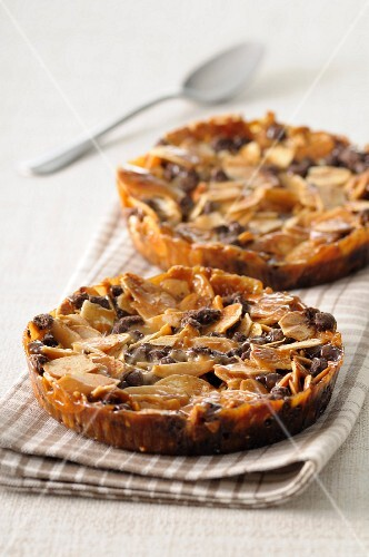 Nougatine,almond and chocolate tartlets
