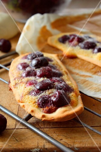 Amandine and cherry sweet pizza