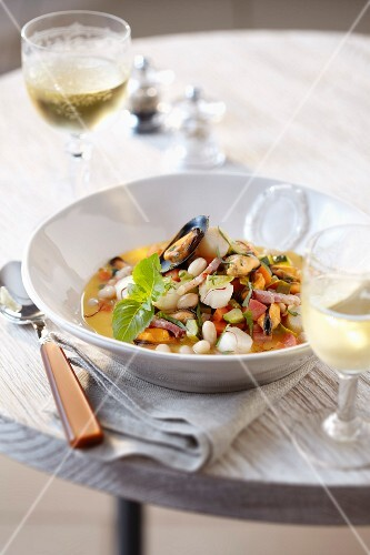 Minestrone-style petoncle scallops and mussels with white beans and saffron