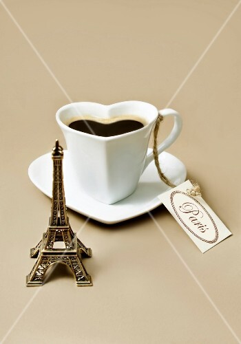 Composition with a mini Eiffel Tower,and a heart-shaped cup of coffee