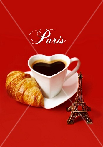 Composition with a mini Eiffel Tower,a heart-shaped cup of coffee and a mini croissant
