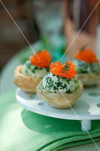 Artichoke bases garnished with mascarpone, alfafa,trout roe and chives