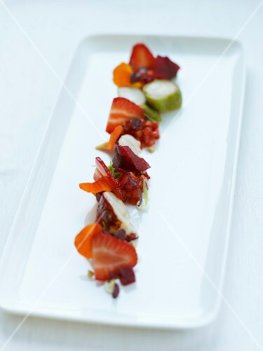 Lobster with stewed strawberries,beetroot jelly and flower sents