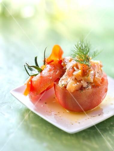 Tomato stuffed with smoked and fresh salmon
