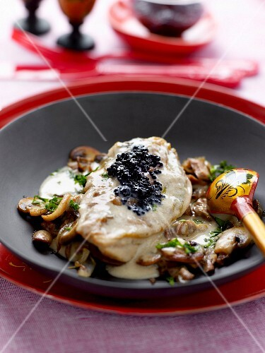 Chicken escalope in creamy mushroom sauce and topped with caviar