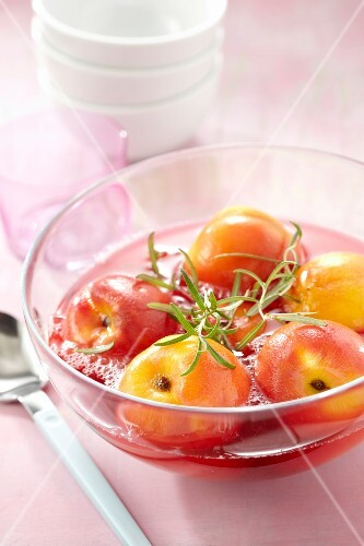 Poached peaches in syrup with rosemary