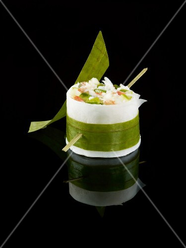 Crab,avocado and green apple black radish makis on a black background