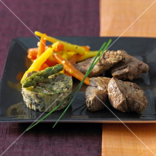 Fillet of beef with carrot duo and small asparagus flan