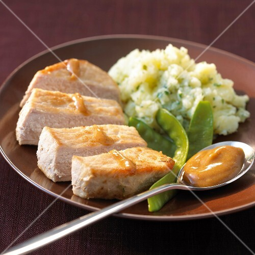 Fillet of pork with Roux sauce,mashed potatoes with herbs,sugar peas