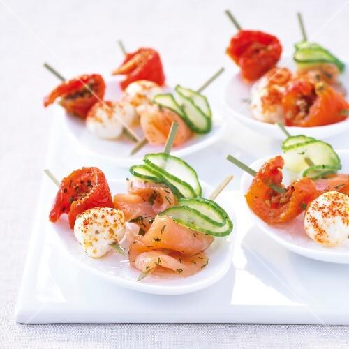 Smoked salmon-dill-cucumber mini brochettes and mozzarella-paprika-confit tomato mini brochettes