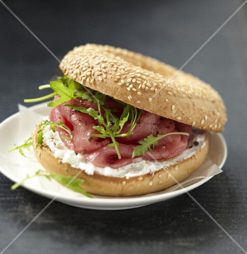Beef carpaccio and Fromage frais bagel sandwich