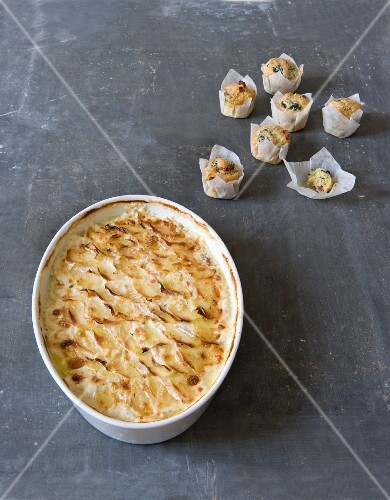 Gratin dauphinois made with Beaufort, small Beaufort, diced bacon and spinach muffins