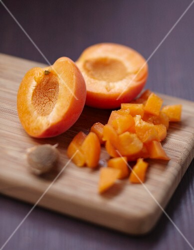 Removing the stones from the apricots and dicing them