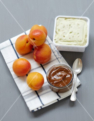 Ingredients for roasted apricots in toffee sauce with pistachio ice cream