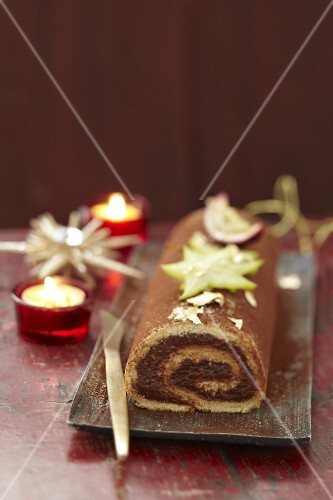 Bûche (French log cake) with chocolate and passion fruit