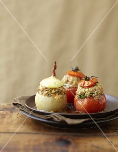 Tomatoes and onions stuffed with meat and cheese